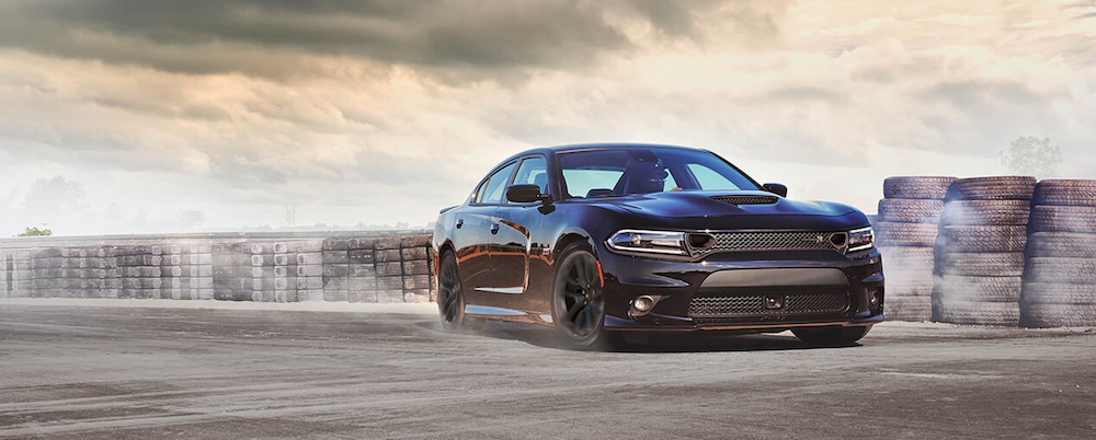 2020 dodge charger black exterior parked on a track