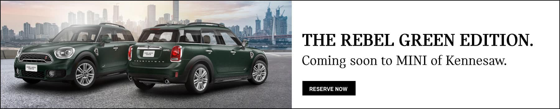 The Rebel Green edition. Coming soon to MINI of Kennesaw. Reserve now button. Two rebel green MINI Cooper S countryman ALL4's parked with city scape in background.
