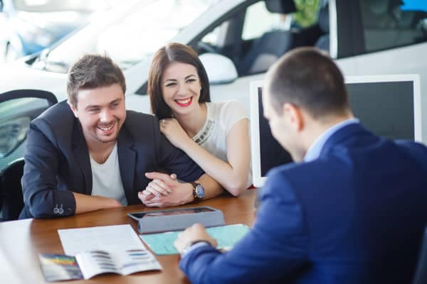 couple talking to dealer finance advisor