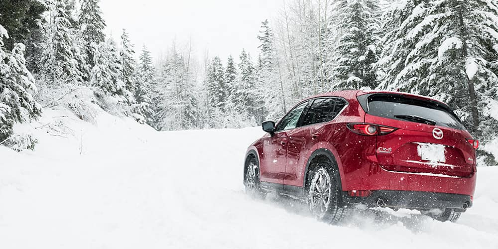 Red 2020 Mazda CX-5 Driving in Snow