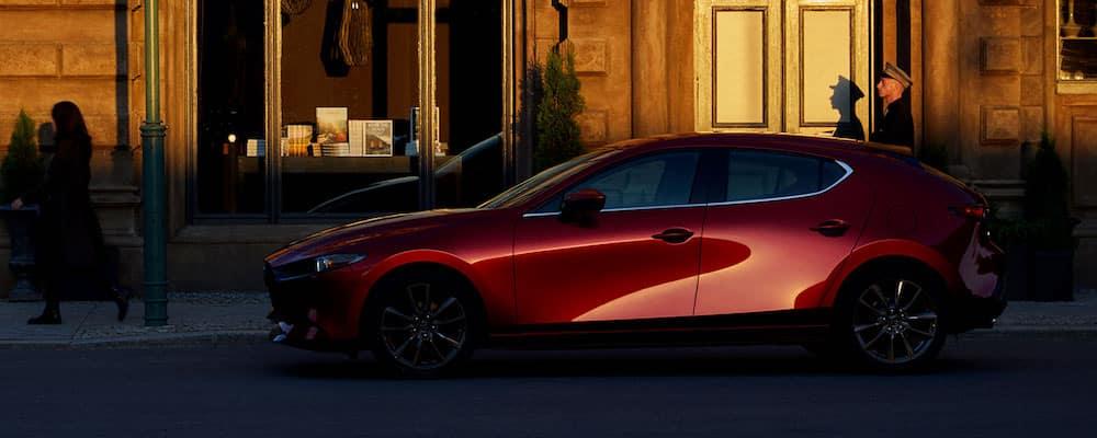 Red 2020 Mazda3 Hatchback Parked On City Street