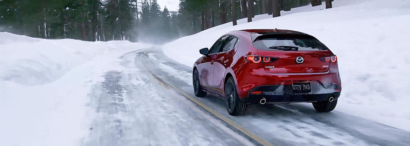 Red 2020 Mazda3 Hatchback on Snowy Road