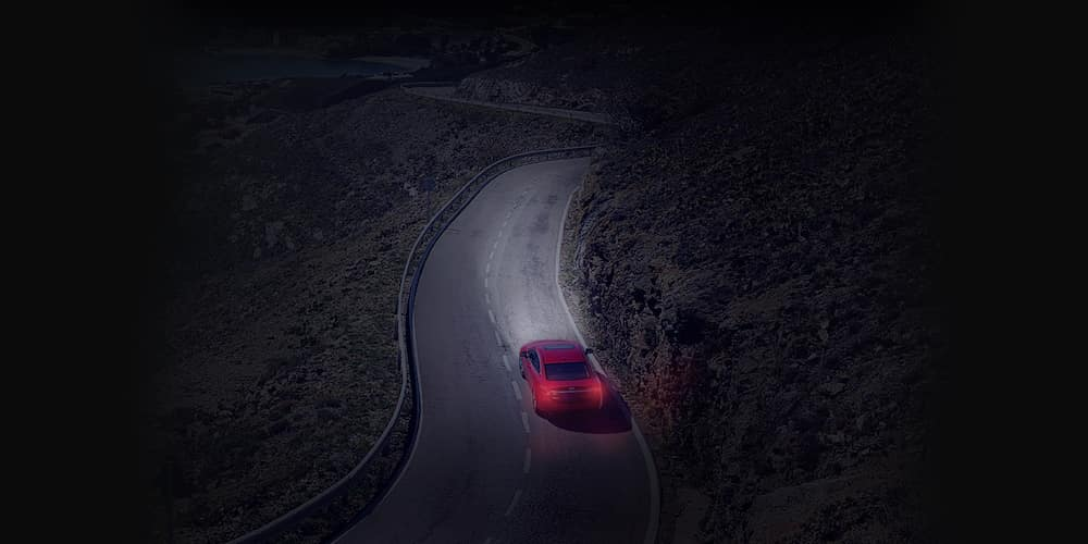 Red Mazda Sedan on Mountainside Highway