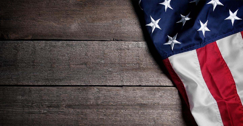 American flag on wood table