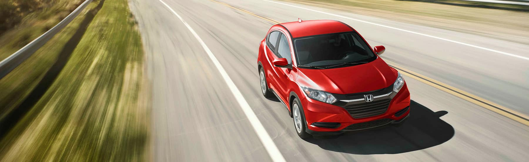Used Honda HR-V driving down the road
