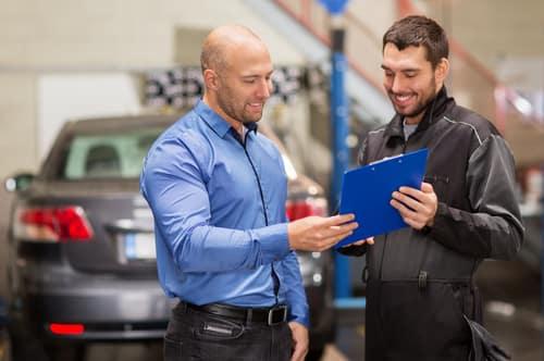 Mechanic talking with customer