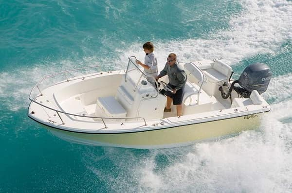 people riding in a center console boat