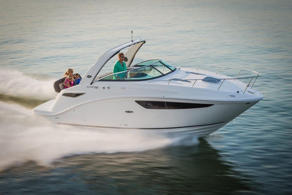 people riding in a small yacht