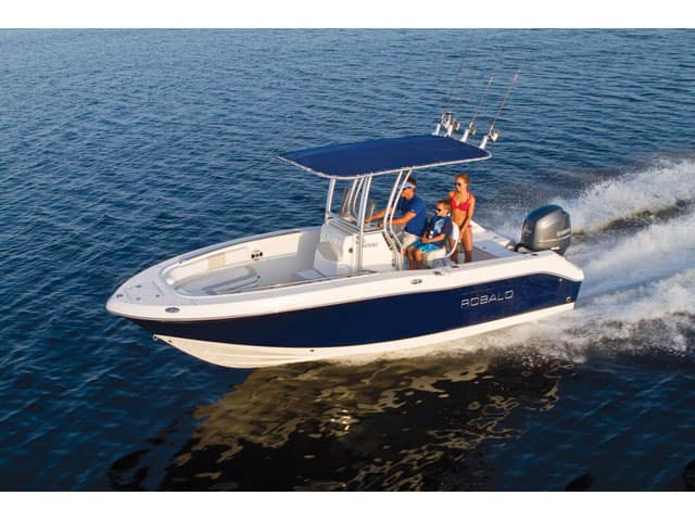 people in a center console robalo boat