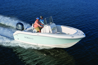 people riding in a robalo center console boat