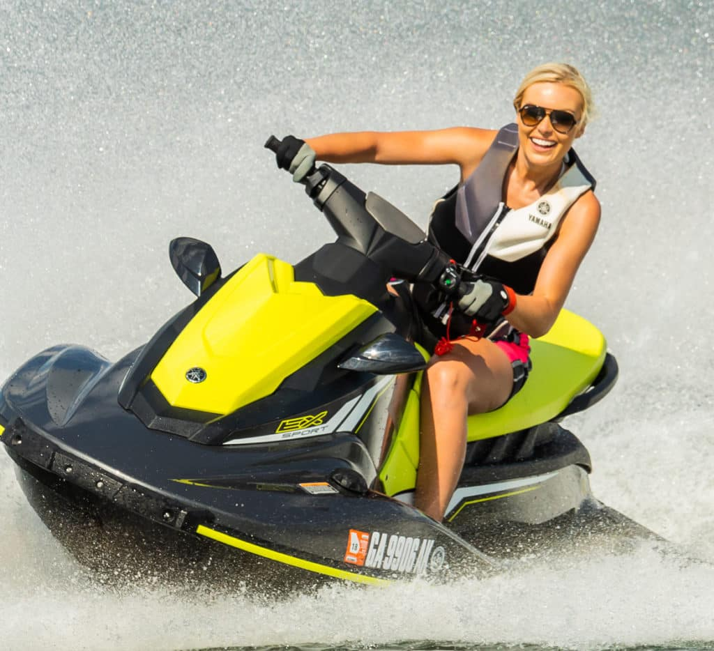 people riding a waverunner