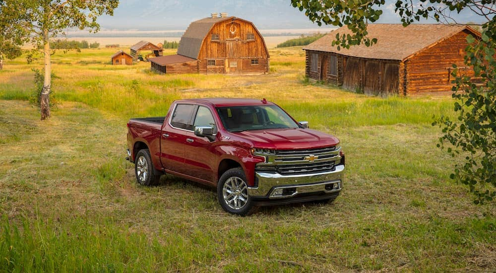 A red 2019 Chevy Silverado is parked near a farm in Bethlehem, PA.