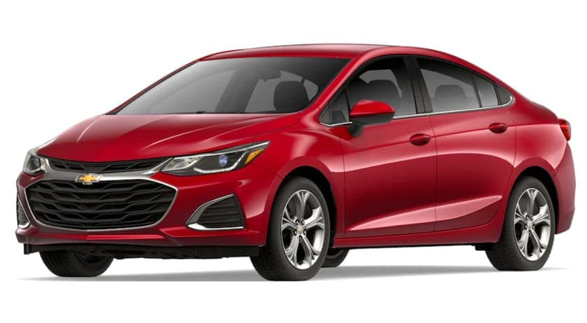 A red 2019 Chevy Cruze is facing left.