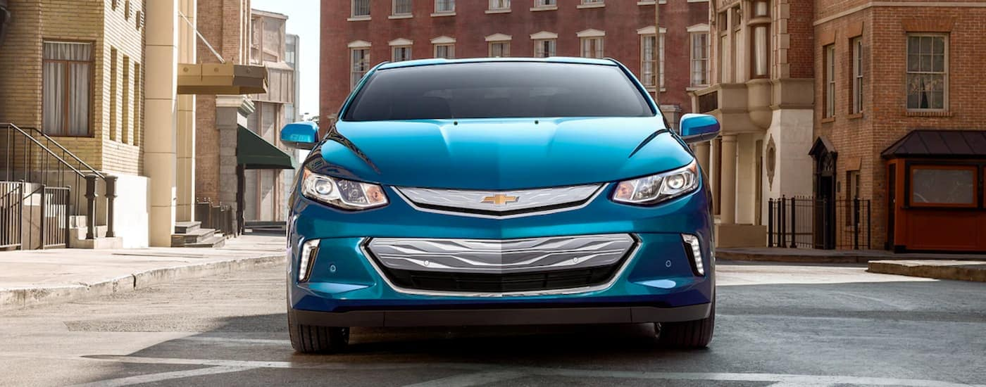 A blue 2019 Chevy Volt is parked on a city street after leaving a Chevy dealership in Bethlehem, PA.