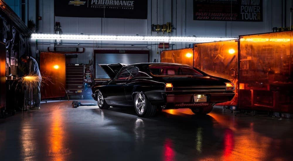 A black Chevelle concept build is parked in a dark garage near a Chevy dealer in Bethlehem, PA.