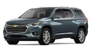 A blue 2019 Chevy Traverse is facing left.