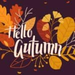 A graphic that says hello autumn with fallen leaves behind it