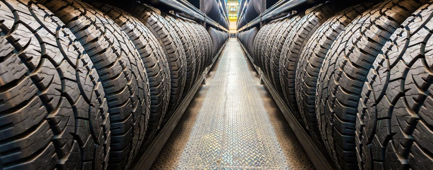 Rows of tires on racks are shown at a Chevy dealer in Bethlehem, PA.