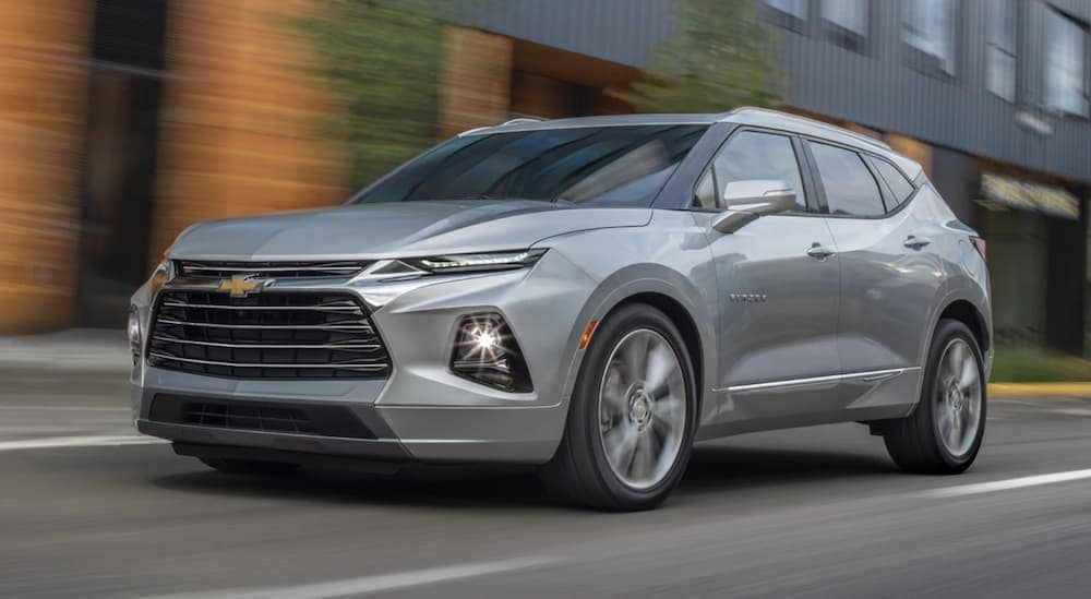 A silver 2019 Chevy Blazer, popular at a Chevy dealer in Bethlehem, PA, is driving through a city.