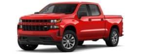 A red 2019 Chevy Silverado is facing left.