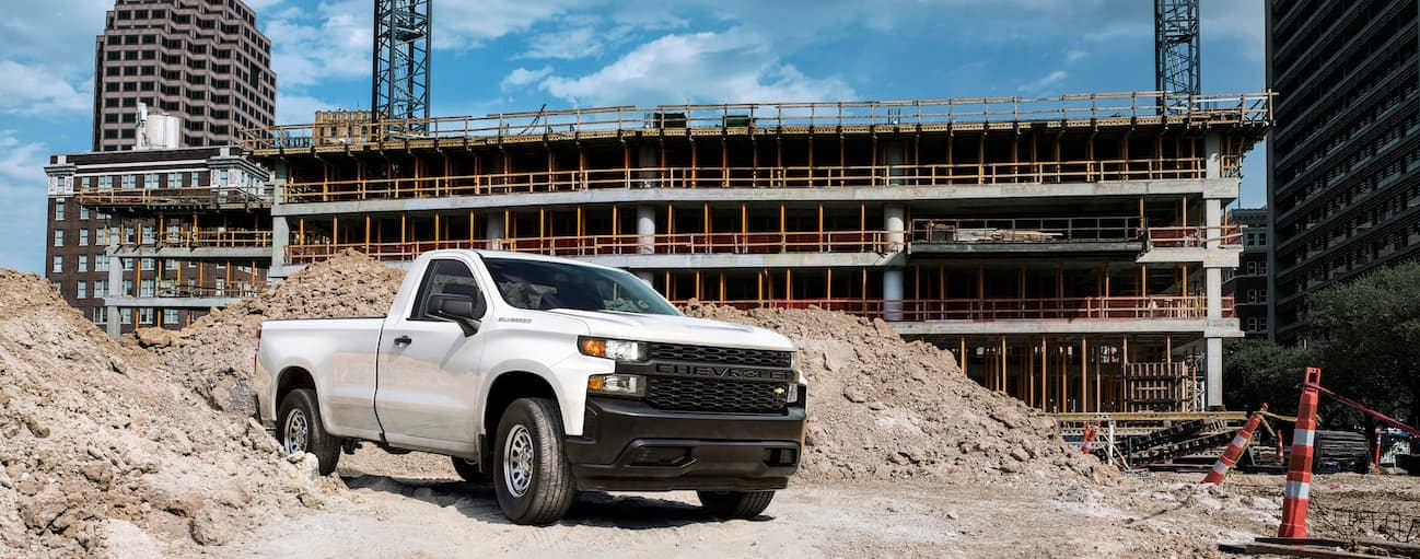 A white 2019 Chevy Silverado is parked at a worksite.