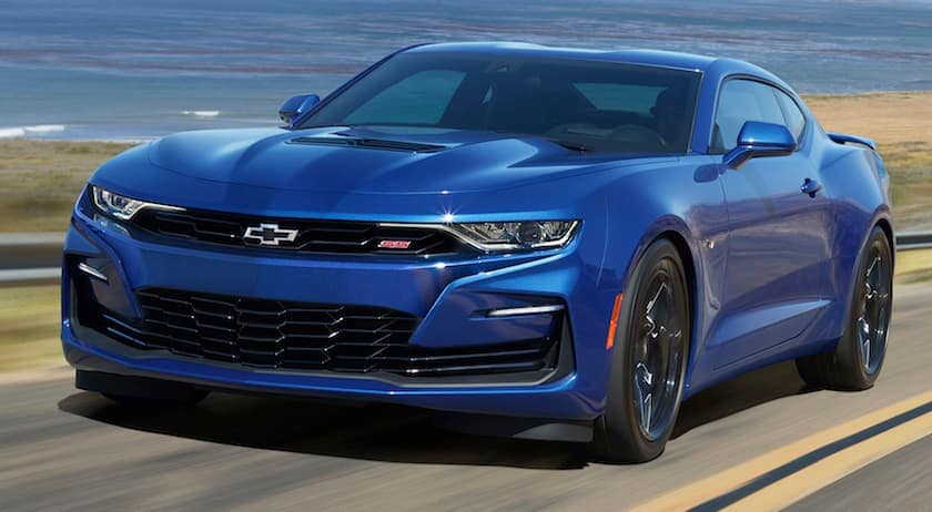 A blue 2020 Chevy Camaro is facing left.