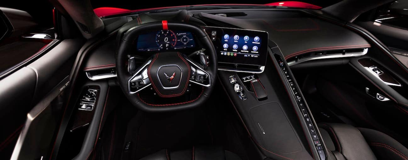 The front black leather interior of the 2020 Chevy Corvette is shown.