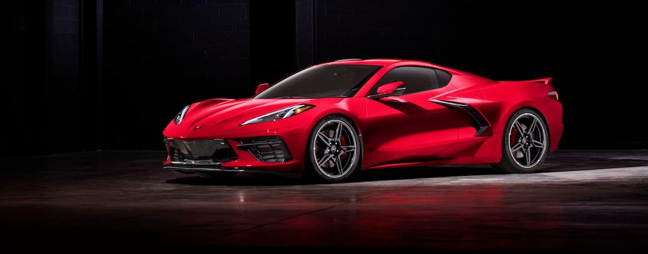 A red 2020 Chevy Corvette, which wins when comparing the 2020 Chevy Corvette vs 2019 Chevy Corvette, is parked in a dark parking lot near Bethlehem, PA.