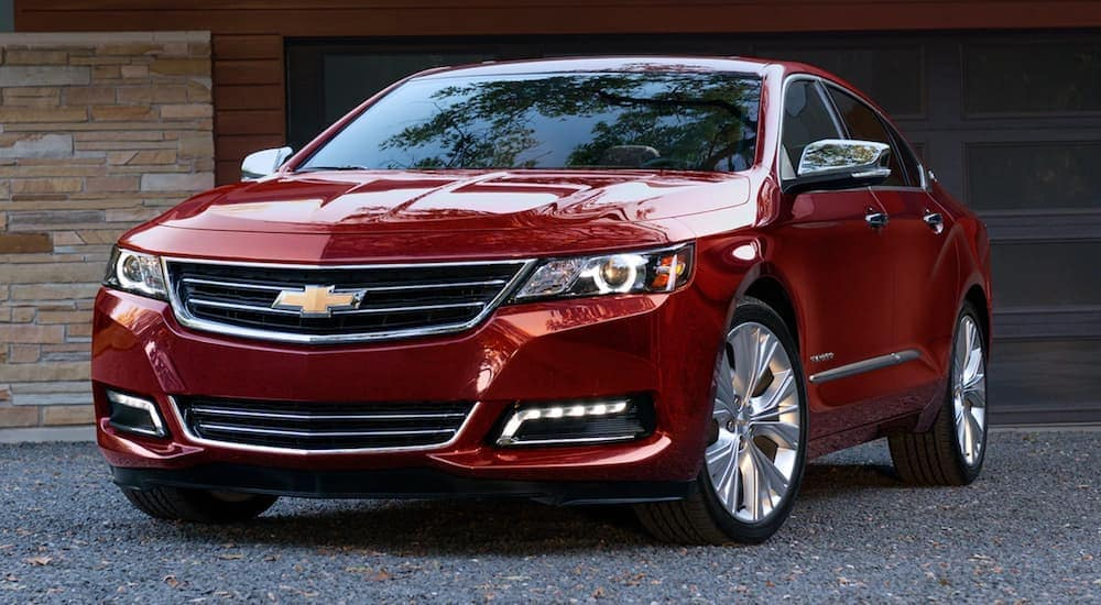 A red 2019 Chevy Impala is parked in front of a garage near Bethlehem, PA.