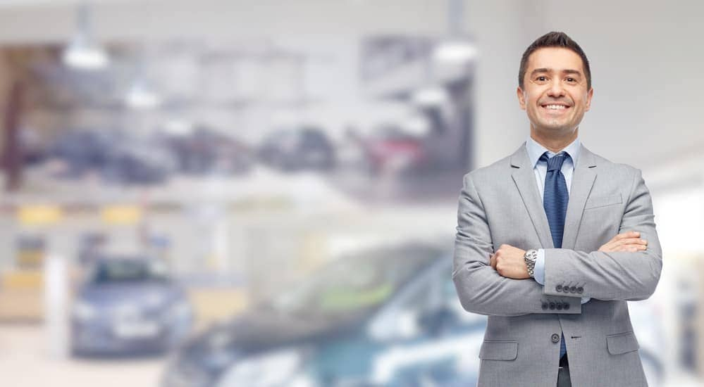 A smiling car salesman at a local Chevy Dealer in the Lehigh Valley.