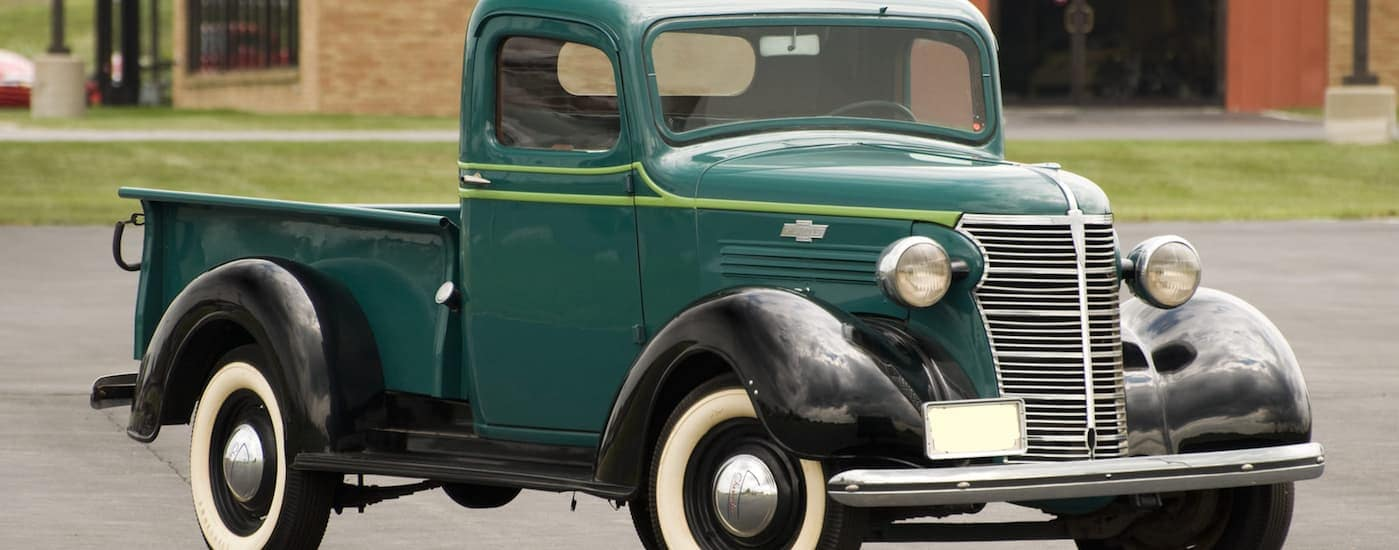 A green 1938 Chevy half ton pickup truck is parked in front of a brick building near Bethlehem, PA.