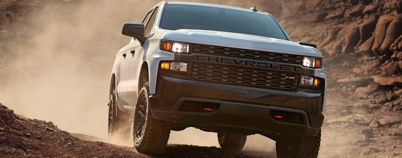 A white 2020 Chevy Silverado 1500 Trailboss is off-roading near Bethlehem. PA.