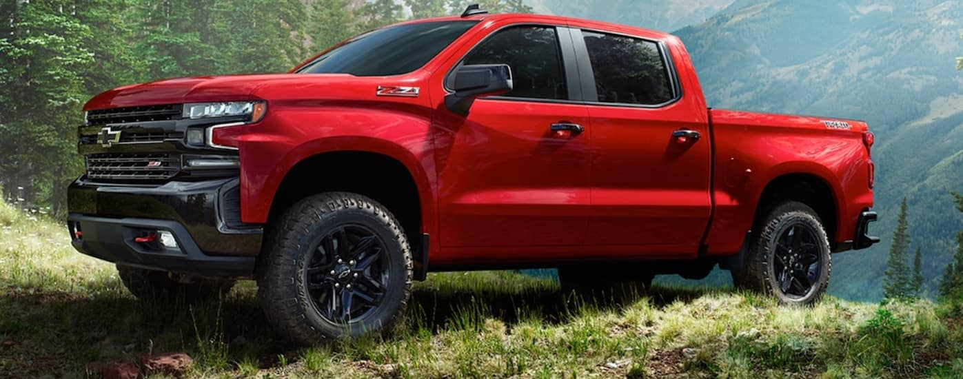 A red 2020 Chevy Silverado Trailboss is off roading in the woods near Bethlehem, PA.