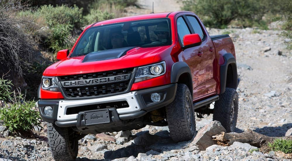 A red 2020 Colorado ZR2 Bison is driving over rocks near Bethlehem ,PA.