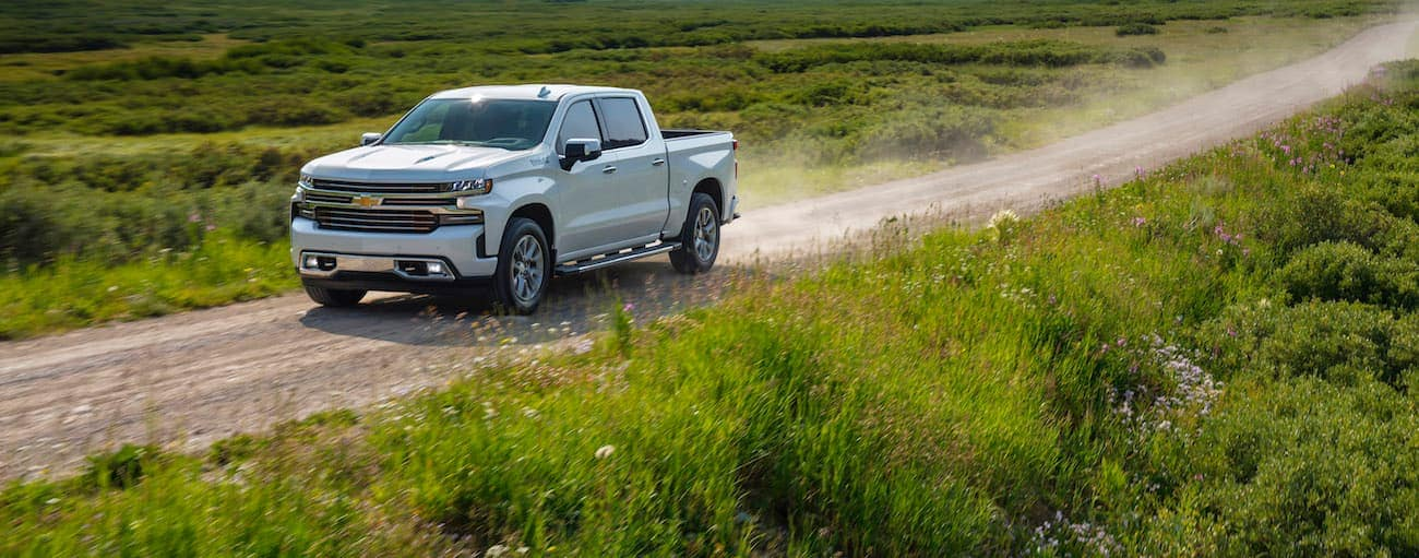 A white 2020 Chevy Silverado 1500 is driving on a dirt road outside Bethlehem, PA.