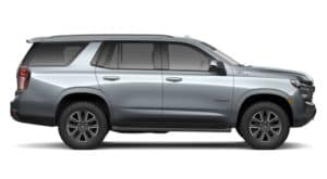 A silver 2021 Chevy Tahoe is shown from the side.