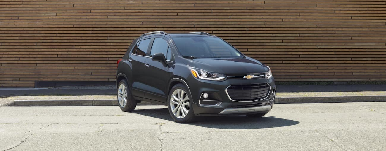 A grey 2020 Chevy Trax is parked in front of a wooden wall near Bethlehem, PA.