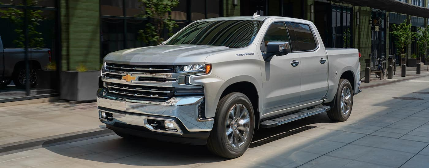 A silver 2020 Chevy Silverado is driving on a city side street in Bethlehem, PA, on the way to do an end of lease turn-in.