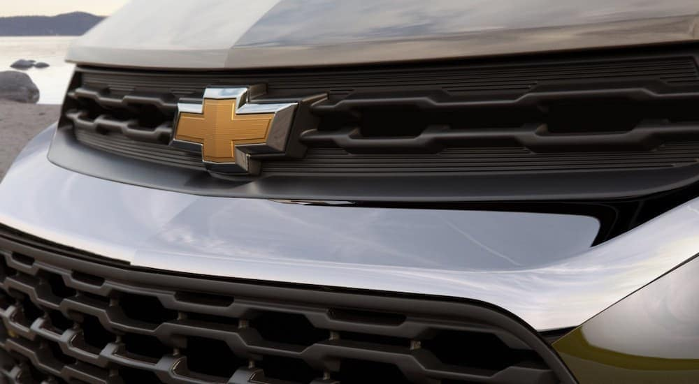 The grille of a silver 2021 Chevy Trailblazer is shown.