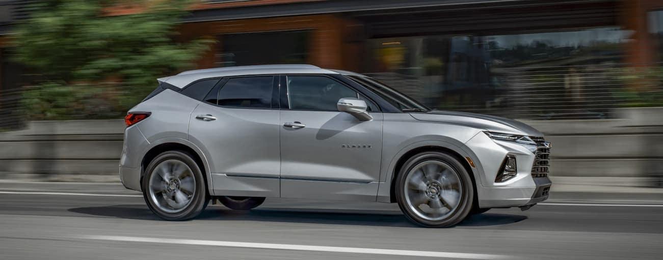 A silver 2020 Chevy Blazer is driving down a city street near Bethlehem, PA.