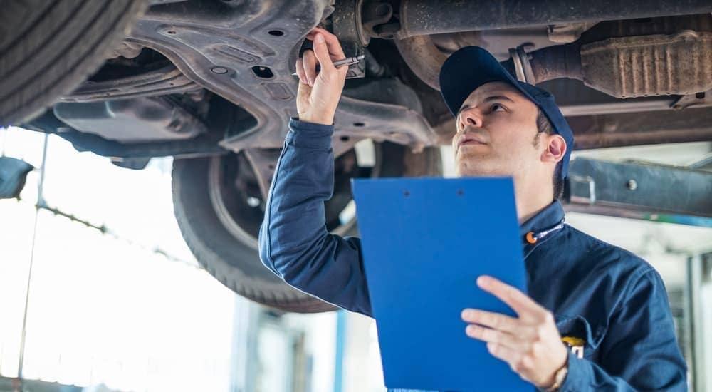 A Bethlehem, PA, mechanic is doing an inspection under a car.