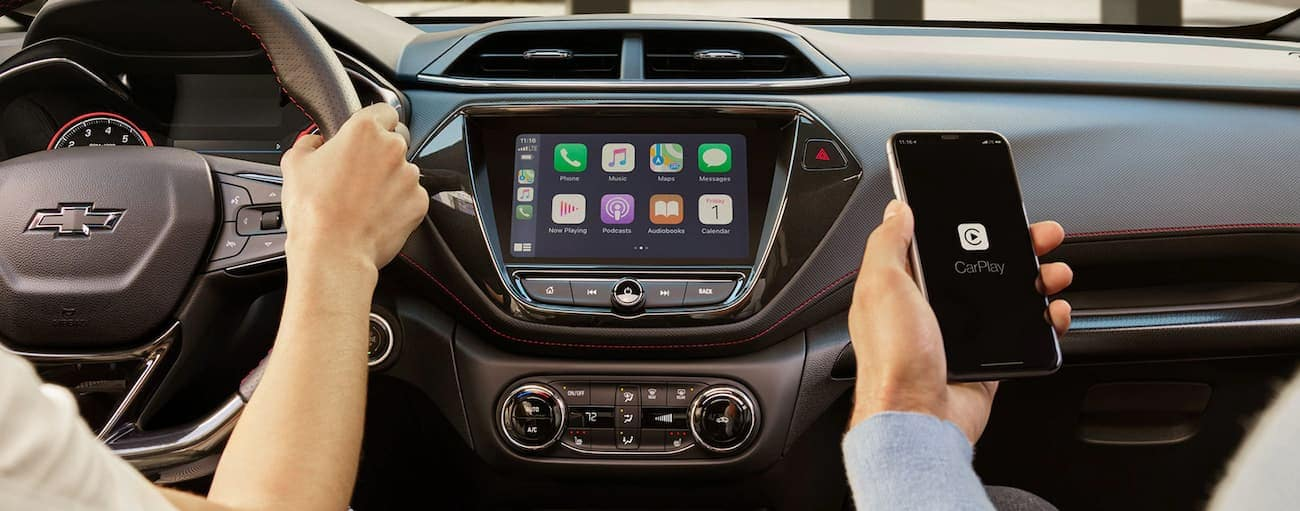 The dashboard and infotainment features like Apple CarPlay are shown on a 2021 Chevy Trailblazer.