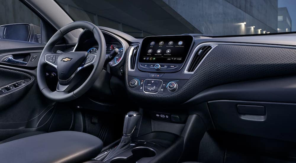 The black interior of a 2020 Chevy Malibu is shown.
