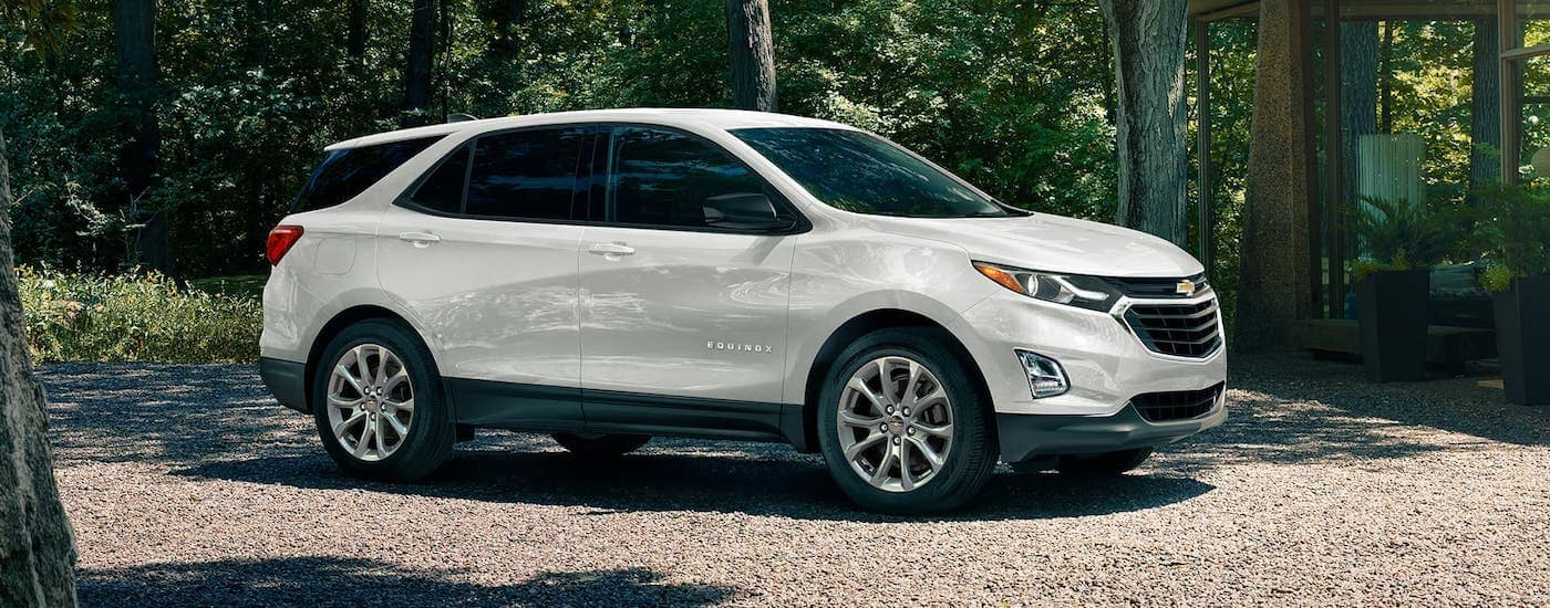 A white 2020 Chevy Equinox is parked in the woods after winning the 2020 Chevy Equinox vs 2020 Ford Escape comparison.