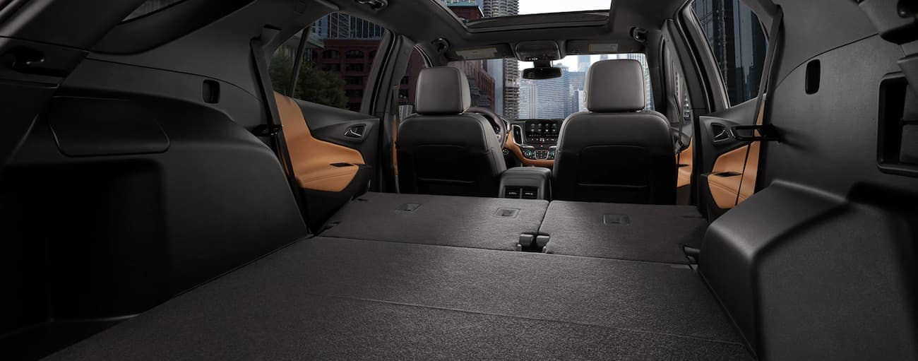 The rear seats are folded down in the back of a 2020 Chevy Equinox.