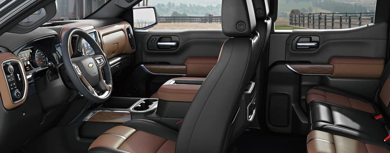 The black and brown interior of a 2021 Chevy Silverado 1500 is shown from the side.