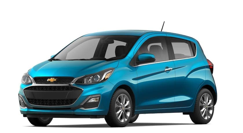 A blue 2021 Chevy Spark is angled left.