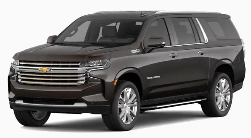 A gray 2021 Chevy Suburban is angled to the left.
