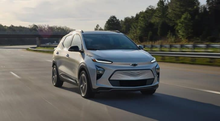 A silver 2022 Chevy Bolt EUV is driving on a highway after leaving a Pennsylvania electric car dealer.