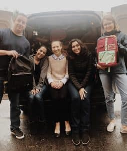 people-smiling-while-sitting-in-the-trunk-of-car